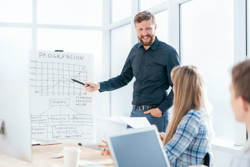 businessman pointing graph during business presentation