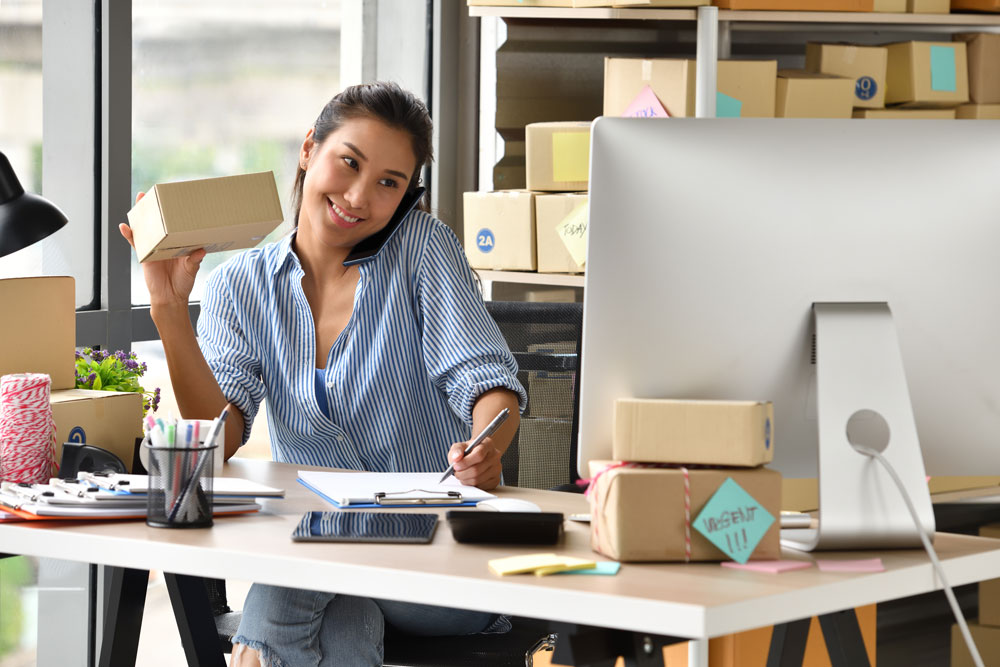 young asian woman entrepreneur business owner working with computer home