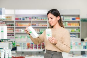 woman choosing vitamins supplements immune system coronavirus pandemic necessity
