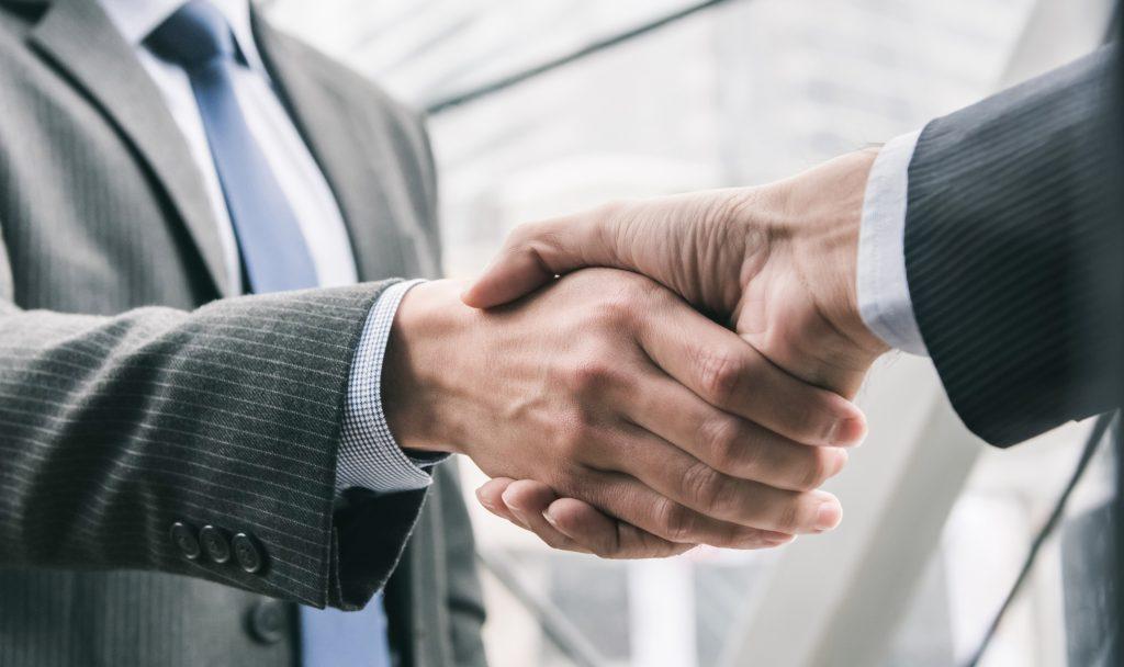 businessman making handshake with partner copy 1